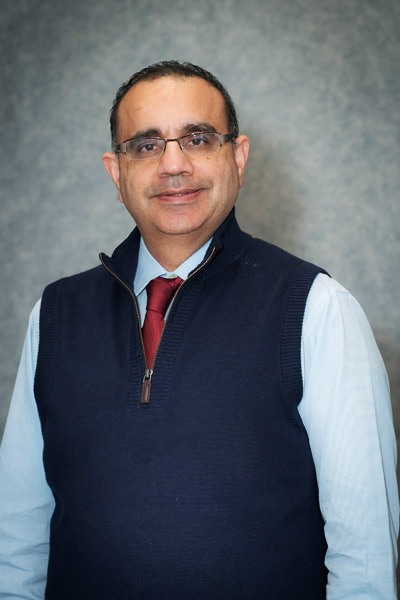 H Paul Singh, asian physician wearing a tie, is a gastroenterologist and works at cary endoscopy center