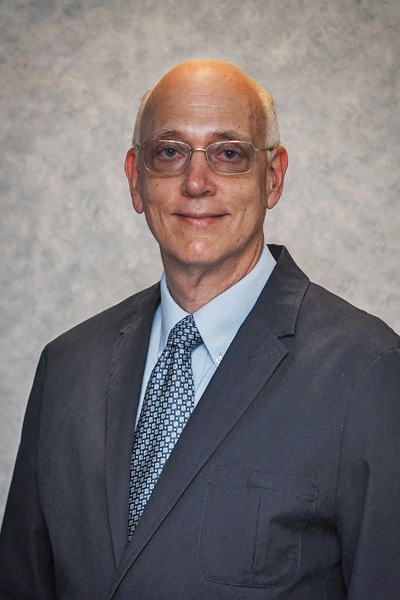 Douglas B Pritchett, caucassian physician wearing suit and tie, is an experienced gastroenterologist in North Carolina